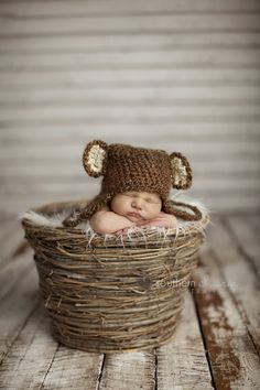 A new born baby in a bear hat.  Taken by Southern Charm Portraits  knoxville tn multiples photography