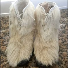 Boots real goat fur short boots beautiful Goat fur boots. Size measures 11 inches by 4 wide by 9 high. Please measure your foot. These boots have minimal wear,the soles are a thick rubber,they lace up the front. Fully lined please see pictures. There is slight wear nothing major at all. These boots would list for over 200.00 check on eBay for the price of goat fur boots you will be surprised. I purchased these in a shop while traveling in Canada. Only wore about 5 times while on trip,Im now…