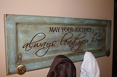 Old cabinet door turned coat rack