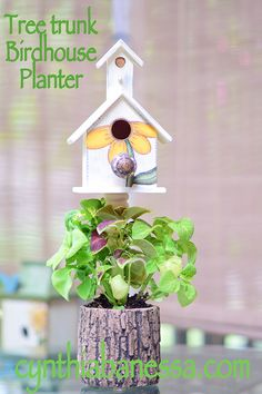 Top a faux tree trunk planter with an adorable birdhouse.