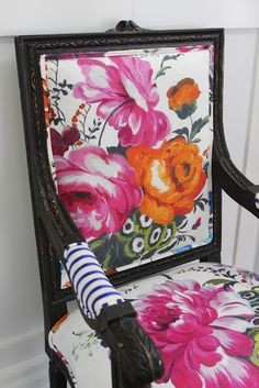 I need an obnoxiously girly, Stepford Wives floral chair someday... that girl is in me.. somewhere.