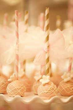 Sweet Simplicity Bakery: Pink, Gold & Ivory Wedding Cake Pops on paper straws with tulle bows