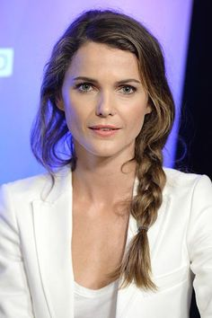 10 Perfect Hairstyles for Thick Hair - Big Braid, Unlike fine-haired ladies, whose braids can look scrawny, your plait is perfectly sized. We love Keri Russell's loose side braid.