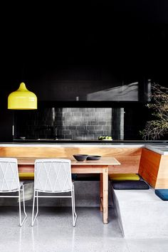 The kitchen has a series of built-in forms that create a kitchen island and bench seating – all in concrete as if the floor has grown upwards to form furniture. As well, the concrete seats are heated so at any time of the year it's comfortable to sit there and enjoy the views of the garden.