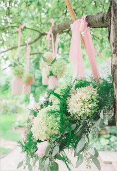 Hanging floral arrangements for a garden wedding #gardenparty #gardenpartywedding #weddingdecor #diywedding #flowers