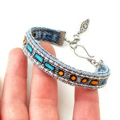 Mich L. in L.A.: Morse Code Blue Jean Bangles     I am not crazy about the painted Morse code but I can see these with silver charms hanging from them, maybe embroidery?