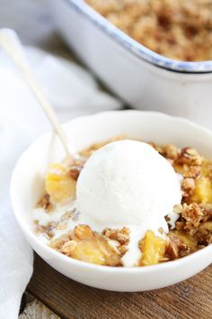 Peach Almond Crisp Recipe on twopeasandtheirpod.com Simple crisp made with fresh peaches and an almond oat topping. Top with ice cream for an extra special dessert!