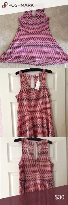Pink Multi Dress Pink multi skater dress with ripple design.  Side zipper. NWT and never been worn. Super cute for summer! Candie's Dresses