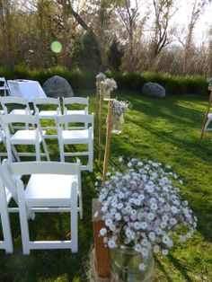 Ceremony posts and chairs.  http://www.tailracecentre.com.au/weddings/