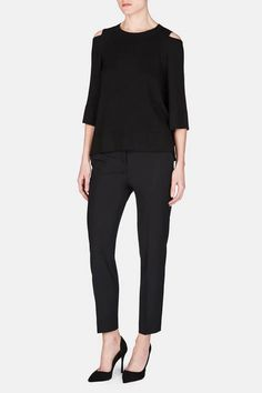 Los Angeles-based designer Soyun Shin crafts fine Italian fibers into Soyer's signature collection of modern knitwear. This deconstructed crewneck sweatshirt reinvents the traditional sportswear favorite as an easy and airy transitional layer. Modest cutouts gracefully bare the shoulders, and the gently flared hem and cropped sleeves give the piece a swingy silhouette.