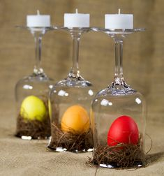 Votive candles, overturned wine glasses, and brilliantly dyed Easter eggs make for the easiest, eye catching tablescape.