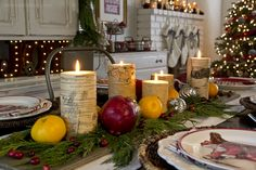 2015 Christmas Dining Room - Yellow Bliss Road.   Fresh cedar, pomegranates, cranberries and oranges from our backyard tree adorn out holiday table, with birch-wrapped candles (World Market) and mercury glass ornaments (Marshalls) nestled in as well. Below them are simple wood planks, stained in weathered gray