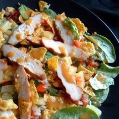Caribbean Chicken Salad - marinated grilled chicken served on mixed greens with spicy jalapeño peppers, sweet pineapple chunks, and a snappy cider vinegar-based dressing. If you like, try it with Jay's Jerk Chicke