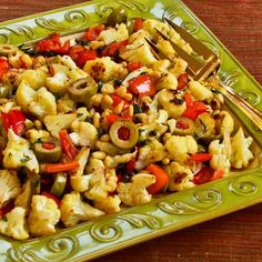 Roasted Cauliflower with Red Bell Pepper, Green Olives, and Pine Nuts (Christmas Caulifiower). If you're looking for a festive idea for vegetables, this is really delicious! [from KalynsKitchen.com] #RedAndGreenFood