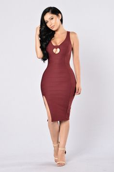 - Available in Burgundy and Black - V Neckline - Fitted - Midi Length - Bandage Look