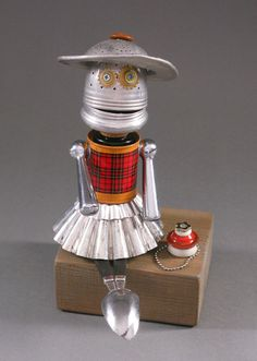 Found Object ROBOT SCULPTURE Polly Pretty by CastOfCharacters23, $125.00 Materials: tea infuser, tea strainer, tin can, faucet handles, food molds, spoons, buttons, watch parts, earring, ball chain necklace