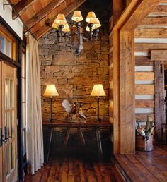 Stone wall in entry A little splash of hunting lodge style swirled into an alluring wooden country chic interior. For my in-laws ranch house remodel