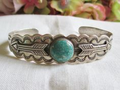 This is breathtaking beautiful! Vintage OLD Fred Harvey Sterling Silver Turquoise With arrows Cuff Bracelet, with awesome design! The…