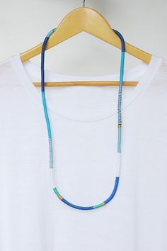 Our love for embroidery thread continues with this DIY wrapped rope necklace. This will be your go-to summer accessory and love wearing your own creation!
