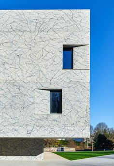 Splattered paintwork inspired by Jackson Pollock covers concrete music school in France