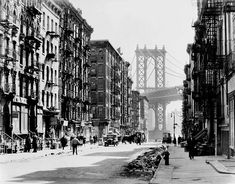 Pike and Henry, Lower East Side, with Manhattan Bridge and a horse. Berenice Abbott photos, 1936.