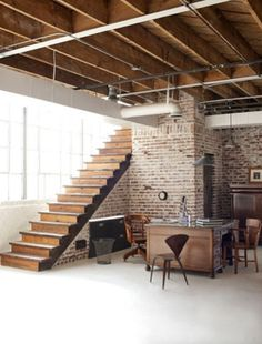 basement - like the brick wall- if only we had those high basement ceilings.