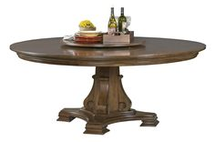 Portolone, a whole-home collection made of solid alder and featuring a rich finish, includes a large round dining table with a lazy Susan. #hpmkt