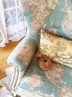 this is the prettiest map project i have seen i couldnt resist pinning it lol the annie sloan vintage world map fabric adds a stylish look to a wingback