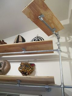 shelf designs = pipes + kee clamps: Wall Mounted Space Saving Studio Workstation