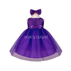 Fancy Baby Dress With Rhinestone And Tulle Skirt : This gorgeous rhinestone purple baby dress features a taffeta bodice and tulle skirt with additional netting underneath for a full volume ballerina skirt look. The waistline is embellished with elegant rhinestone jewels, delicate beading, and sequin.