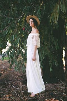 A gorgeous gown with a '70s vibe is perfect for a casual summer wedding.