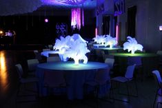 The feathers were placed inside vases that were filled with glow water. Glow water is so simple to make--we hammered a high lighter until it cracked and then pulled out the wick and dropped it in the water. After a few hours, we took the wicks out and voila, your water is glowing!!