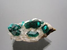 A personal favourite from my Etsy shop https://www.etsy.com/listing/480440770/cool-dioptase-specimen-from-kazakhstan