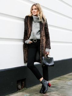 Lucy Williams of Fashion Me Now wearing a leopard coat, grey funnel neck sweater, black skinny jeans and matching black leather accessories.