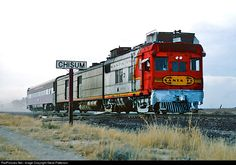 "Santa Fe's articulated doodlebug M190 and one coach were running 75 mph when they zipped by the Chisum, N.M. station sign. Train 25 operated between Clovis and Carlsbad and informally was called the ""Pecos Valley Chief."" The M190 survives today at the Museum of American Railroads at Frisco, Texas."