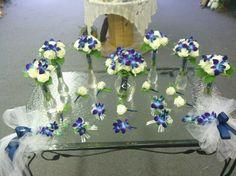 Emily's Wedding; white roses, blue bomb orchids!