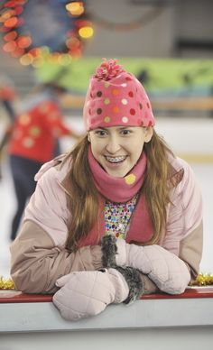Sue Heck of ABC's The Middle. Her Outfits and enthusiasm- love love love. She's cool by me.