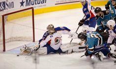 Worcester Sharks forwards Travis Oleksuk, Dan DaSilva and Yanni Gourde crash the net as Norfolk Admirals goaltender John Gibson makes a save (Jan. 17, 2014).