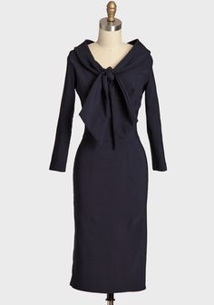 """Love this.  Angie Dress By Queen Of Heartz  shopruche.com. Impeccably crafted, this vintage-inspired navy dress by Queen of Heartz boasts three-quarter length sleeves, a classic necktie, and the perfect hint of stretch for a defined silhouette. Completed in a longer length with a hidden back zipper closure and kick pleat for graceful movement.100% Polyester, Made in USA , 40.75"""" length from top of shoulders"""