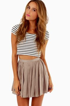 Striped cropped top and chiffon pleated skirt.