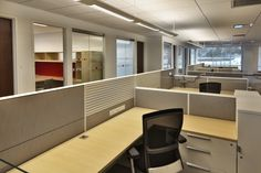 Open Workstation area with Glass front offices. Teknion Workstations.