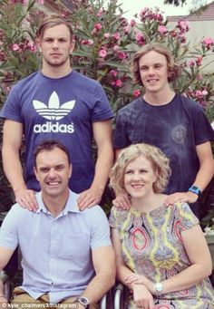 He was watched on by his family (right), including dad Brett, mum Jodie and…