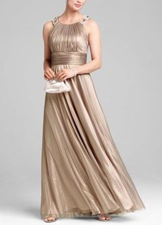 Stand out in this gorgeous gown, great for a mother of the bride or groom! Jewel neckline is embellished with pearls and stones. Ruched waist and full skirt flatter any body type. Iridescent tulle is classic and elegant. Fully lined. Back zip. Imported polyester. Dry clean only. Also available in Plus sizes as Style 741943D.