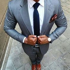 Follow @gentlemenslegacy STRIPED Gray pin stripe two piece, knitted navy blue tie, crisp white shirt and burgundy pocket square