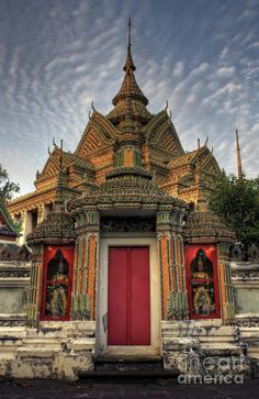 Wat Pho at twilight - Thailand.  Let us get you there on a cheap business or first class flight at flymebusiness.com