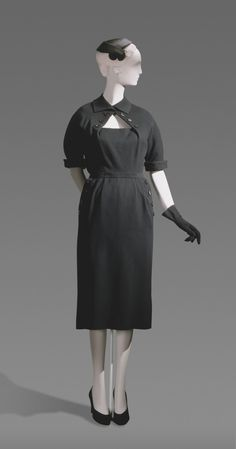 Circa 1952 Christian Dior black wool suit, made in Paris, France.