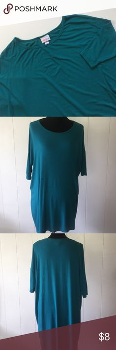 LuLaRoe Irma Top Teal colored Irma tunic top. Slightly ribbed material. Size medium but runs large and long. Only used once but has a small hole on the left lower side that can be easily stitched up. LuLaRoe Tops Tunics