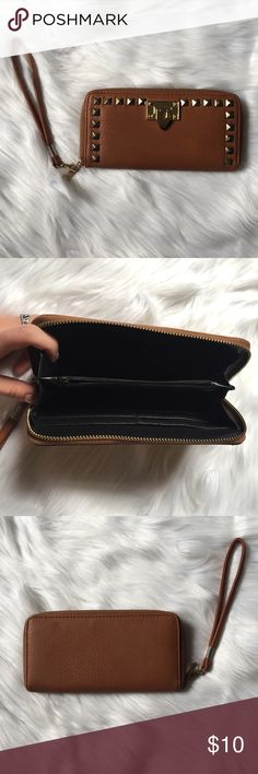Wristlet Studded embellishment wristlet. In great condition. Feel free to ask any additional questions.   💕 please make offers through offer button 💰 bundle for a 20% off discount  🚬🐶 smoke & pet free home  🚫 sorry no trades Bags Clutches & Wristlets