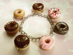 box of donuts polymer clay charm bracelet doughnut charms. $30.00, via Etsy.
