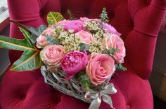 Floral arrangement made in heart shaped wiker basket with Esperance roses,pink peonies,white wax flower,baby blue eucalyptus and croton leaves,designed by Adrian Ionita